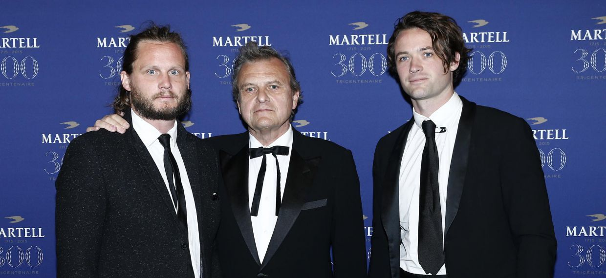 Jean Charles de Castelbajac (C) and his sons Louis-Marie de Castelbajac and Guilhem de Castelbajac at the Palace of Versailles for Martell300 anniversary